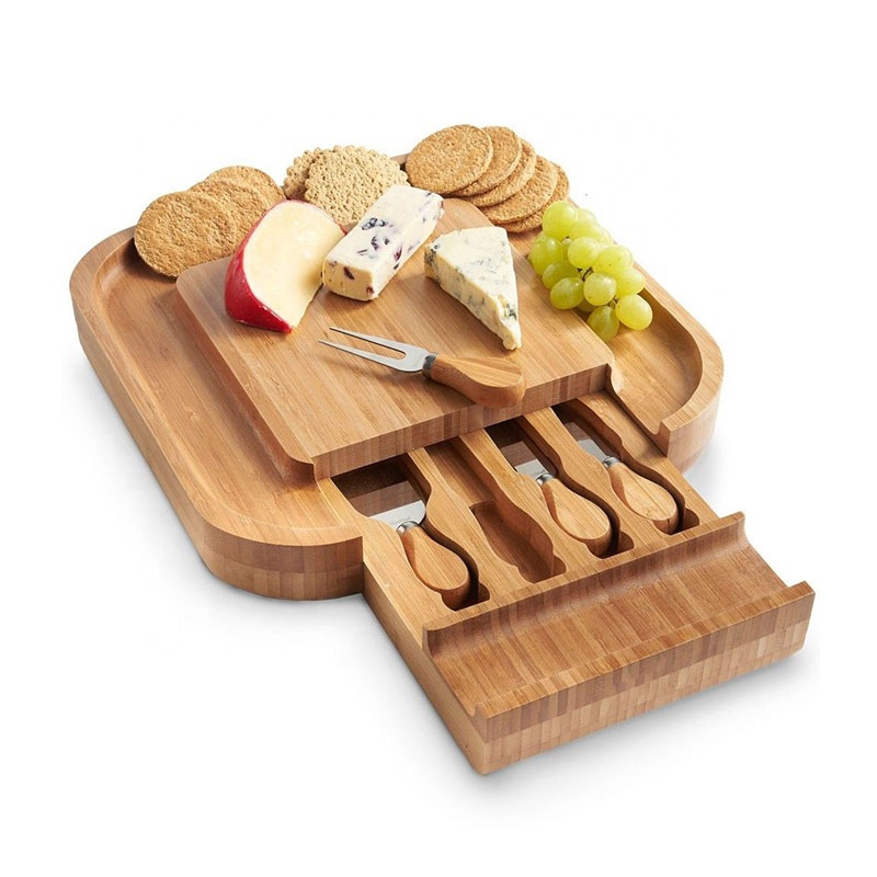 Round bamboo cheese board set with cutlery in drawer